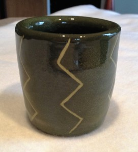 """Again, I used a slip and then carved the """"lightening"""" pattern, followed by a glaze."""