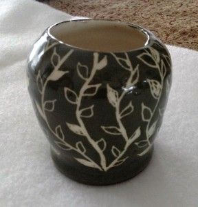 """When the clay is still wet, you """"paint"""" it with a paint called a slip. After it dries, you carve out a pattern and then fire the piece. After that I added a clear glaze."""